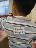 Nicky's name tag on his back